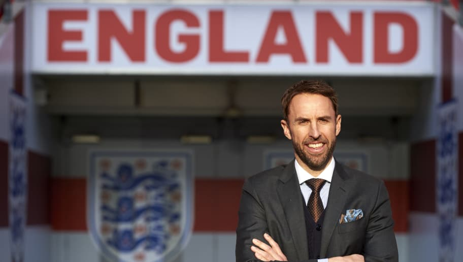 England's new manager Gareth Southgate poses for photographers during a media session at Wembley stadium in London on December 1, 2016. Gareth Southgate was appointed England's new full-time manager on Wednesday November 30, and will lead the national team's challenge for the 2018 World Cup and 2020 European Championship. The 46-year-old, who has been in charge of the England squad for four games on a temporary basis, signed a four-year contract, the Football Association (FA) announced.  / AFP / Niklas HALLE'N / NOT FOR MARKETING OR ADVERTISING USE / RESTRICTED TO EDITORIAL USE        (Photo credit should read NIKLAS HALLE'N/AFP/Getty Images)