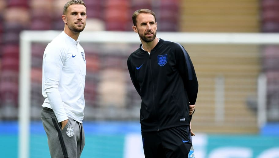 England's midfielder Jordan Henderson (L) and England's coach Gareth Southgate inspect the pitch of the Luzhniki Stadium in Moscow on July 10, 2018, on the eve of their Russia 2018 World Cup semi-final football match against Croatia. (Photo by YURI CORTEZ / AFP)        (Photo credit should read YURI CORTEZ/AFP/Getty Images)