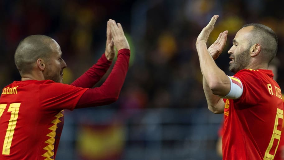 Spain's midfielder Andres Iniesta (R) celebrates with midfielder David Silva after scoring during the international friendly football match Spain against Costa Rica at La Rosaleda stadium in Malaga on November 11, 2017.  / AFP PHOTO / JORGE GUERRERO        (Photo credit should read JORGE GUERRERO/AFP/Getty Images)