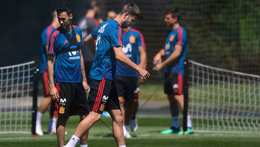 Spain's defender Gerard Pique (C) attends a training session in Krasnodar Academy on June 11, 2018, ahead of the Russia 2018 World Cup football tournament. (Photo by Pierre-Philippe MARCOU / AFP)        (Photo credit should read PIERRE-PHILIPPE MARCOU/AFP/Getty Images)