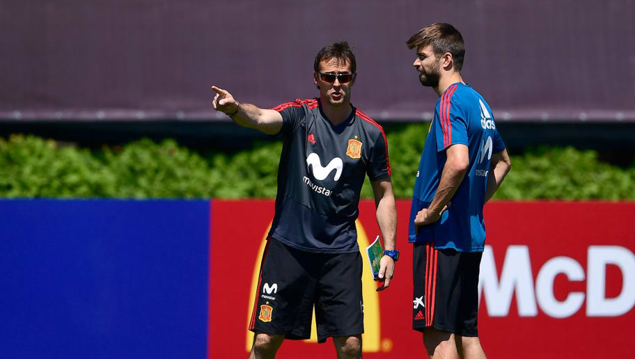 Spain's coach Julen Lopetegui (L) speaks with defender Gerard Pique during a training session at Krasnodar Academy on June 12, 2018, ahead of the Russia 2018 World Cup football tournament. (Photo by Pierre-Philippe MARCOU / AFP)        (Photo credit should read PIERRE-PHILIPPE MARCOU/AFP/Getty Images)