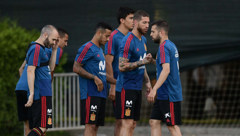 (L to R) Spain's midfielder Andres Iniesta, forward Rodrigo, midfielder Thiago Alcantara, defender Sergio Ramos and defender Jordi Alba take part in a training session at Krasnodar Academy on June 13, 2018, ahead of the Russia 2018 World Cup football tournament. - Spain today named the federation sporting director Fernando Hierro as its World Cup coach to replace Julen Lopetegui, who was sensationally sacked after his appointment as Real Madrid manager. (Photo by PIERRE-PHILIPPE MARCOU / AFP)        (Photo credit should read PIERRE-PHILIPPE MARCOU/AFP/Getty Images)