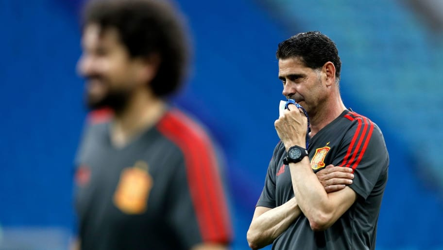 Spain's coach Fernando Hierro watches his team players during a training session at the Fisht Olympic Stadium in Sochi on June 14, 2018, on the eve of the Russia 2018 World Cup Group B football match between Portugal and Spain. (Photo by Adrian DENNIS / AFP)        (Photo credit should read ADRIAN DENNIS/AFP/Getty Images)