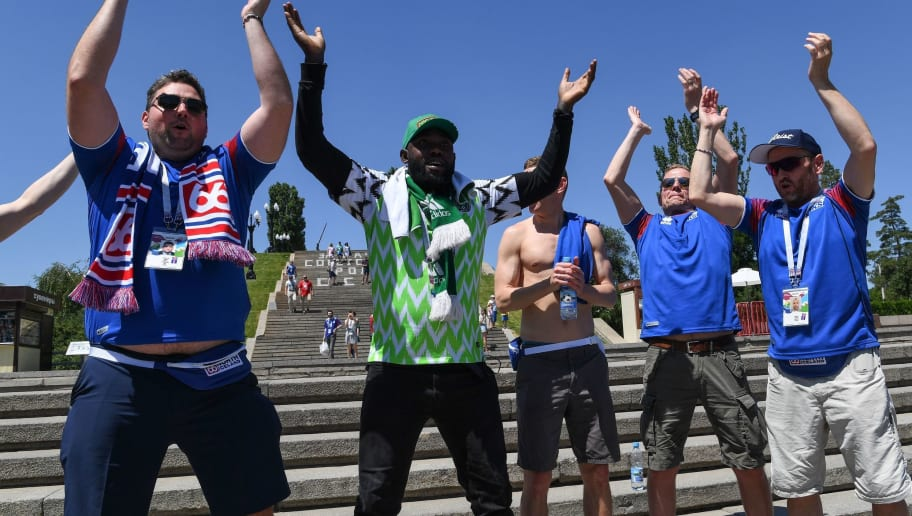 Iceland's and Nigerian supporters visit the Mamayev Kurgan World War Two memorial complex in Volgograd on June 22, 2018, hours before the Russia 2018 World Cup Group D football match between Nigeria and Iceland. (Photo by PHILIPPE DESMAZES / AFP)        (Photo credit should read PHILIPPE DESMAZES/AFP/Getty Images)