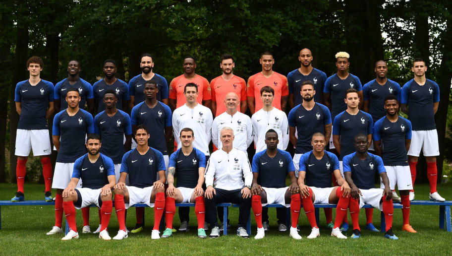 France's national football team (3rd row, from L): France's defender Benjamin Pavard, France's defender Benjamin Mendy, France's defender Samuel Umtiti, France's defender Adil Rami, France's goalkeeper Steve Mandanda, France's goalkeaper Hugo Lloris, France's goalkeeper Alphonse Aerola, France's midfielder Steven N'zonzi , France's defender Presnel Kimpembe, France's defender Djibril Sidibé and France's defender Lucas Hernandez, (2nd row, from L) France's midfielder Corentin Tolisso, France's forward Ousmane Dembele, France's midfielder Paul Pogba, goalkeeper coach Franck Raviot, assistant coach Guy Stephan, physical trainer Gregory Dupont, France's forward Olivier Giroud, France's forward Florian Thauvin, France's midfielder Thomas Lemar, (front row, from L) France's forward Nabil Fekir, France's defender Raphael Varane, France's forward Antoine Griezmann, France's head coach Didier Deschamps, France's midfielder Blaise Matuidi, France's forward Kylian Mbappe and France's midfielder N'Golo Kante pose on May 30, 2018 in Clairefontaine-en-Yvelines, ahead of the upcoming FIFA World Cup 2018 in Russia. (Photo by FRANCK FIFE / AFP)        (Photo credit should read FRANCK FIFE/AFP/Getty Images)