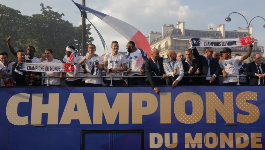 (From L) France's goalkeeper Hugo Lloris, France's midfielder Paul Pogba, France's forward Florian Thauvin, France's forward Ousmane Dembele, France's forward Antoine Griezmann, France's defender Lucas Hernandez, France's goalkeeper Steve Mandanda and (2nd R) France's forward Kylian Mbappe celebrate with teammates on the roof of a bus while parading down the Champs-Elysee avenue in Paris, on July 16, 2018 after winning the Russia 2018 World Cup final football match. (Photo by GEOFFROY VAN DER HASSELT / AFP)        (Photo credit should read GEOFFROY VAN DER HASSELT/AFP/Getty Images)