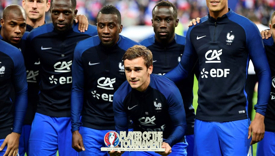 France's forward Antoine Griezmann (C) poses with his teammates (From L) Djibril Sidibe, Laurent Koscielny, Moussa Sissoko, Blaise Matuidi, Bacary Sagna, Raphael Varane and Layvin Kurzawa after he received the trophy for best player of Euro 2016 before the FIFA World Cup 2018 qualifying football match France vs Bulgaria on October 7, 2016  at the Stade de France stadium in Saint-Denis, north of Paris.   / AFP / FRANCK FIFE        (Photo credit should read FRANCK FIFE/AFP/Getty Images)