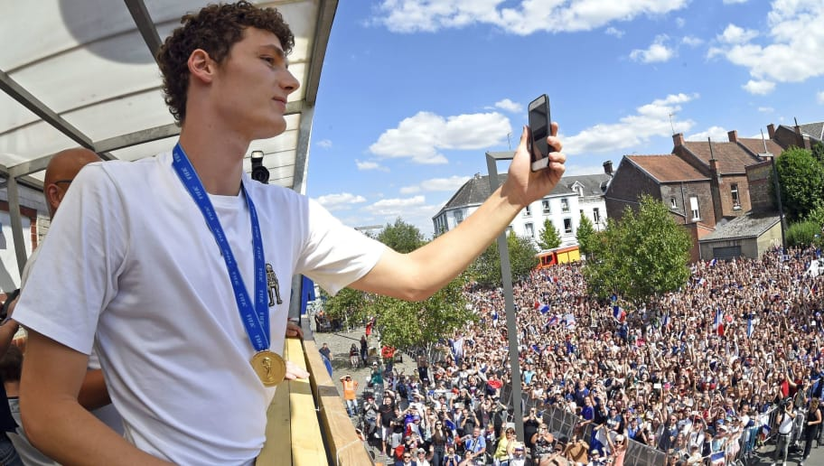 France's defender Benjamin Pavard takes a picture of the crowd gathered in his home town of Jeumont, northern France, on July 18, 2018 three days after French players won the Russia 2018 World Cup final football match. (Photo by FRANCOIS LO PRESTI / AFP)        (Photo credit should read FRANCOIS LO PRESTI/AFP/Getty Images)