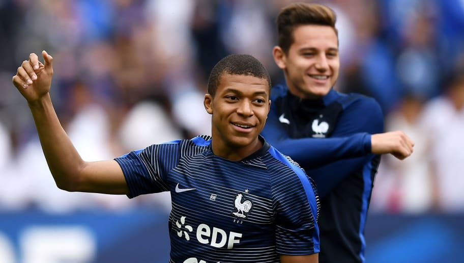 France's forward Kylian Mbappe (L) and France's forward Florian Thauvin warm up ahead of the international friendly football match between France and England at The Stade de France Stadium in Saint-Denis near Paris on June 13, 2017.                 / AFP PHOTO / FRANCK FIFE        (Photo credit should read FRANCK FIFE/AFP/Getty Images)