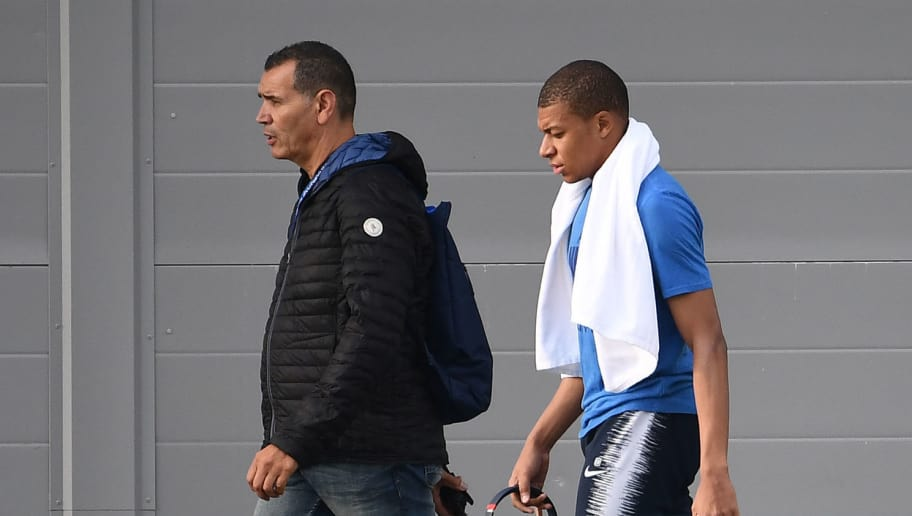 France's forward Kylian Mbappe (R) leaves a training session after getting injured at the Glebovets stadium in Istra, on June 12, 2018, ahead of the Russia 2018 World Cup football tournament. (Photo by FRANCK FIFE / AFP)        (Photo credit should read FRANCK FIFE/AFP/Getty Images)