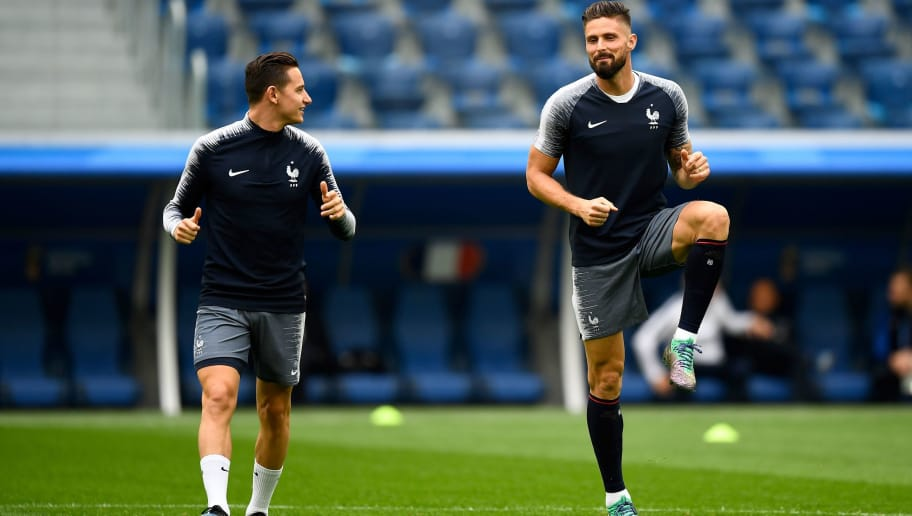 France's forward Florian Thauvin (L) and France's forward Olivier Giroud (R) take part in a training session of France's national football team at the Saint Petersburg Stadium, in Saint Petersburg, on July 9, 2018, on the eve of their Russia 2018 World Cup semi-final football match against Belgium. (Photo by GABRIEL BOUYS / AFP)        (Photo credit should read GABRIEL BOUYS/AFP/Getty Images)