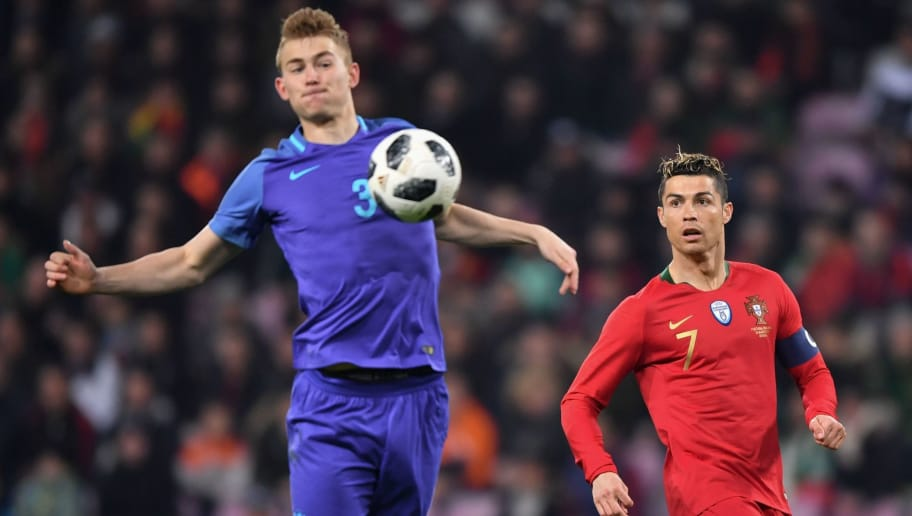 Netherlands' defender Matthijs de Ligt (L) and Portugal's forward Cristiano Ronaldo fight for the ball  during their international friendly football match between Portugal and Netherlands at Stade de Geneve stadium in Geneva on March 26, 2018. / AFP PHOTO / Fabrice COFFRINI        (Photo credit should read FABRICE COFFRINI/AFP/Getty Images)
