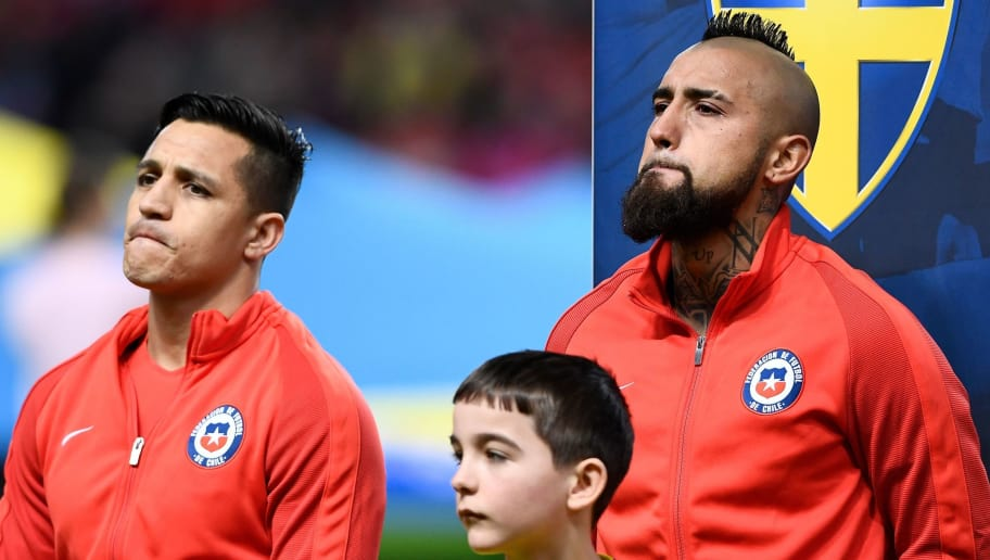 Chile's forward and team captain Alexis Sanchez and Chile's midfielder Arturo Vidal (R) stand still prior the international friendly football match between Sweden and Chile at Friends Arena in Solna on March 24, 2018.  / AFP PHOTO / Jonathan NACKSTRAND        (Photo credit should read JONATHAN NACKSTRAND/AFP/Getty Images)