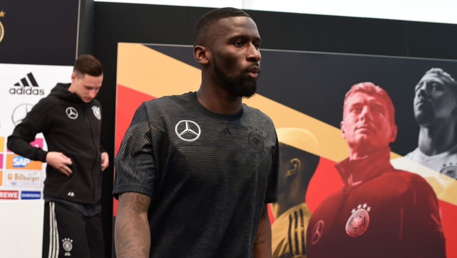 German national football team midfielder Julian Draxler (L) and defender Antonio Rudiger leave after a press conference at the Rungghof training center in Girlan, close to Bolzano, northeastern Italy, on May 28, 2018 ahead of the FIFA World Cup 2018 in Russia. (Photo by MIGUEL MEDINA / AFP)        (Photo credit should read MIGUEL MEDINA/AFP/Getty Images)