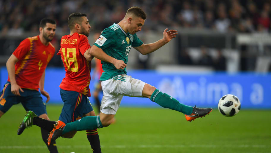 Germany's midfielder Joshua Kimmich (R) and Spain's defender Jordi Alba vie for the ball during the international friendly football match of Germany vs Spain in Duesseldorf, western Germany, on March 23, 2018, in preparation of the 2018 Fifa World Cup. / AFP PHOTO / Patrik STOLLARZ        (Photo credit should read PATRIK STOLLARZ/AFP/Getty Images)