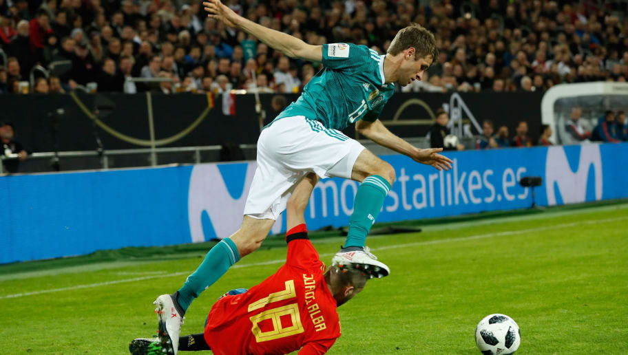 Germany's forward Thomas Mueller (top) and Spain's defender Jordi Alba vie for the ball during the international friendly football match of Germany vs Spain in Duesseldorf, western Germany, on March 23, 2018, in preparation of the 2018 Fifa World Cup. / AFP PHOTO / Odd ANDERSEN        (Photo credit should read ODD ANDERSEN/AFP/Getty Images)