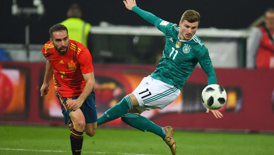 Spain's defender Daniel Carvajal (L) and Germany's striker Timo Werner vie for the ball during the international friendly football match of Germany vs Spain in Duesseldorf, western Germany, on March 23, 2018, in preparation of the 2018 Fifa World Cup. / AFP PHOTO / Patrik STOLLARZ        (Photo credit should read PATRIK STOLLARZ/AFP/Getty Images)