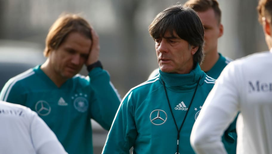 Germany's head coach Joachim Loew talks to his players during a training session of the German team ahead of their friendly football match Germany vs Brazil in Berlin, Germany, on March 25, 2018, in preparation of the 2018 Fifa World Cup. Germany plays against Brazil on March 27, 2018. / AFP PHOTO / Odd ANDERSEN        (Photo credit should read ODD ANDERSEN/AFP/Getty Images)