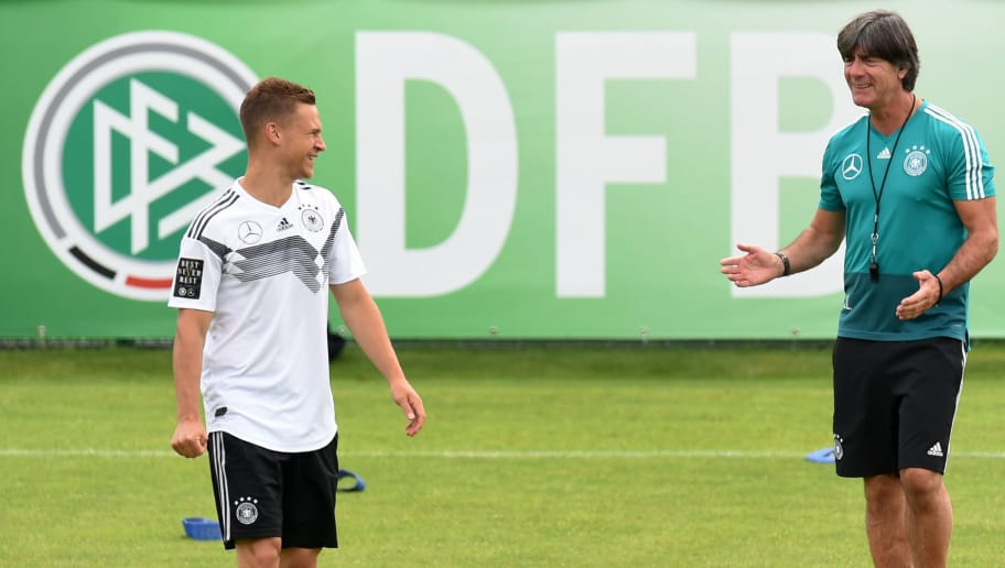 Germany's head coach Joachim Loew (R) shares a smile with Germany's midfielder Joshua Kimmich during a training session of the German national football team at the Rungghof training centre on June 7, 2018 in Eppan near Bolzano, northern Italy, ahead of the FIFA World Cup 2018 in Russia. (Photo by Christof STACHE / AFP)        (Photo credit should read CHRISTOF STACHE/AFP/Getty Images)