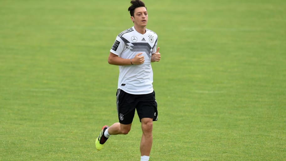 Germany's midfielder Mesut Ozil attends a training session of the German national football team at the Rungghof training centre on June 7, 2018 in Eppan near Bolzano, northern Italy, ahead of the FIFA World Cup 2018 in Russia. (Photo by Christof STACHE / AFP) / LARGER VERSION        (Photo credit should read CHRISTOF STACHE/AFP/Getty Images)
