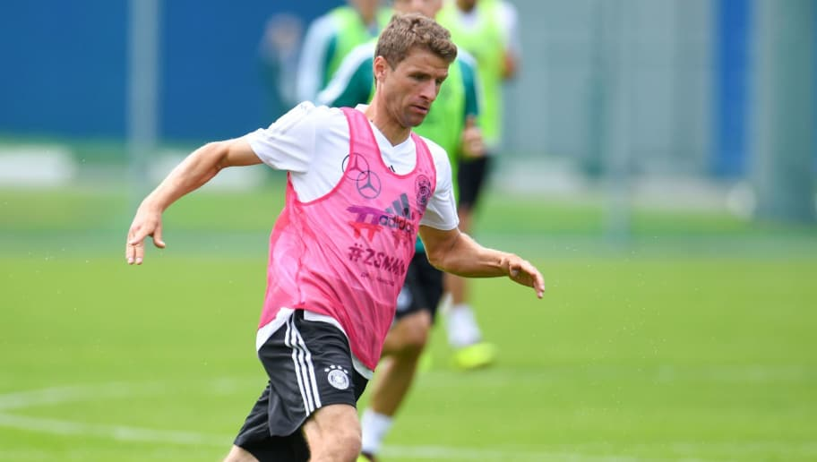 Germany's forward Thomas Mueller runs with the ball during a training session in Vatutinki, near Moscow, on June 13, 2018, ahead of the Russia 2018 World Cup football tournament. (Photo by Patrik STOLLARZ / AFP)        (Photo credit should read PATRIK STOLLARZ/AFP/Getty Images)