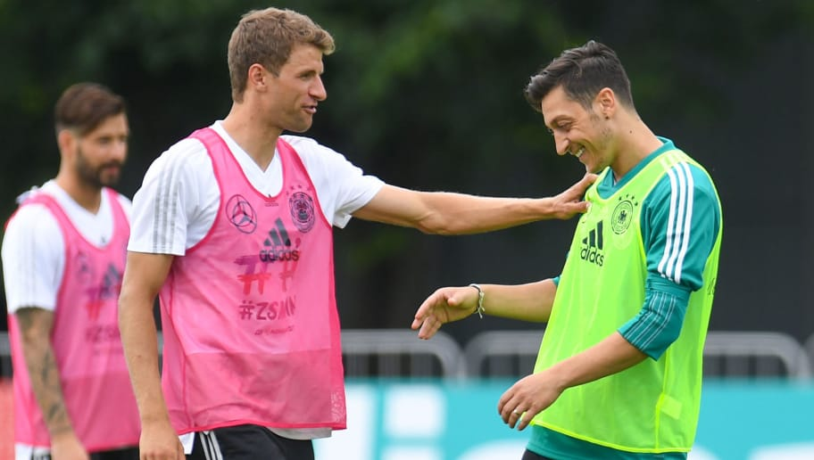 Germany's forward Thomas Mueller (L) and midfielder Mesut Ozil talk during a training session in Vatutinki, near Moscow, on June 13, 2018, ahead of the Russia 2018 World Cup football tournament. (Photo by Patrik STOLLARZ / AFP)        (Photo credit should read PATRIK STOLLARZ/AFP/Getty Images)