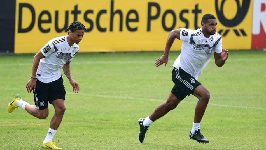 German national football team forward Leroy Sane (L) and German national football team defender Jonathan Tah take part in a training session at the Rungghof training center on May 29, 2018 in Girlan, near Bolzano, northern Italy, ahead of the FIFA World Cup 2018 in Russia. - The 'Mannschaft' will remain in Rungghof until June 7, 2018. (Photo by MIGUEL MEDINA / AFP)        (Photo credit should read MIGUEL MEDINA/AFP/Getty Images)