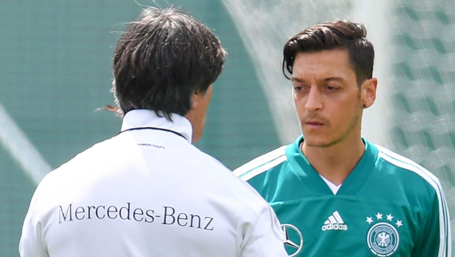 Germany's coach Joachim Loew (L) talks to midfielder Mesut Ozil during a training session in Vatutinki, near Moscow, on June 13, 2018, ahead of the Russia 2018 World Cup football tournament. (Photo by Patrik STOLLARZ / AFP)        (Photo credit should read PATRIK STOLLARZ/AFP/Getty Images)