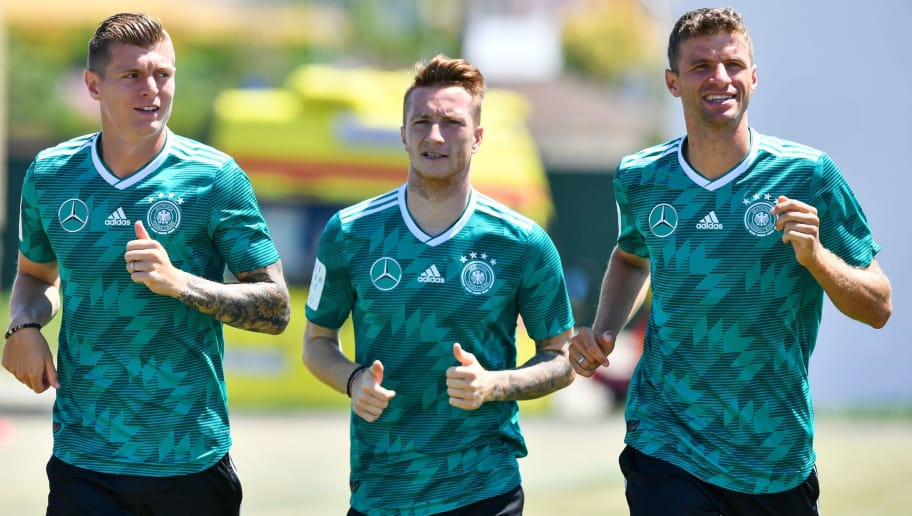 L to R, Germany's midfielder Toni Kroos, Germany's forward Marco Reus and Germany's forward Thomas Mueller take part in a training session at the Olympic Park Arena in Sochi on June 21, 2018, during the Russia 2018 football World Cup. (Photo by Nelson Almeida / AFP)        (Photo credit should read NELSON ALMEIDA/AFP/Getty Images)