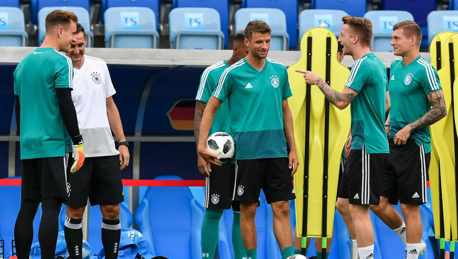 L to R, Germany's goalkeeper Marc-Andre Ter Stegen, coaching assistant Miroslav Klose, Germany's forward Thomas Mueller, Germany's forward Marco Reus and Germany's midfielder Toni Kroos attend a training session at the Fisht Olympic Stadium in Sochi on June 22, 2018, on the eve of the Russia 2018 World Cup Group F football match between Germany and Sweden. (Photo by Nelson Almeida / AFP)        (Photo credit should read NELSON ALMEIDA/AFP/Getty Images)