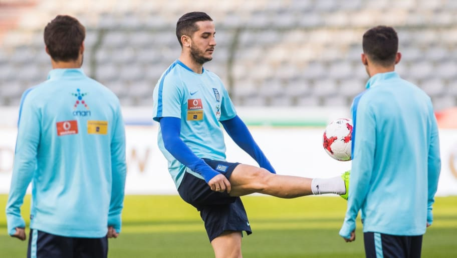 Greece's Kostas Manolas  takes part in a training session  on the eve of the FIFA World Cup 2018 qualifying football match against Belgium, on March 24, 2017, in Brussels. / AFP PHOTO / Belga / LAURIE DIEFFEMBACQ / Belgium OUT        (Photo credit should read LAURIE DIEFFEMBACQ/AFP/Getty Images)