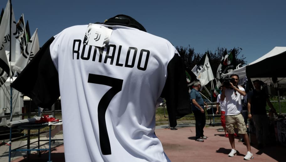 A picture taken on July 7, 2018 in Turin shows a Cristiano Ronaldo's Juventus T-shirt in a stand near the Allianz Stadium in Turin. - Spain's media said goodbye to superstar Cristiano Ronaldo while Italy's welcomed him on Friday after persistent reports that the five-time Ballon d'Or winner will leave Real Madrid for Italian champions Juventus. (Photo by Isabella Bonotto / AFP)        (Photo credit should read ISABELLA BONOTTO/AFP/Getty Images)