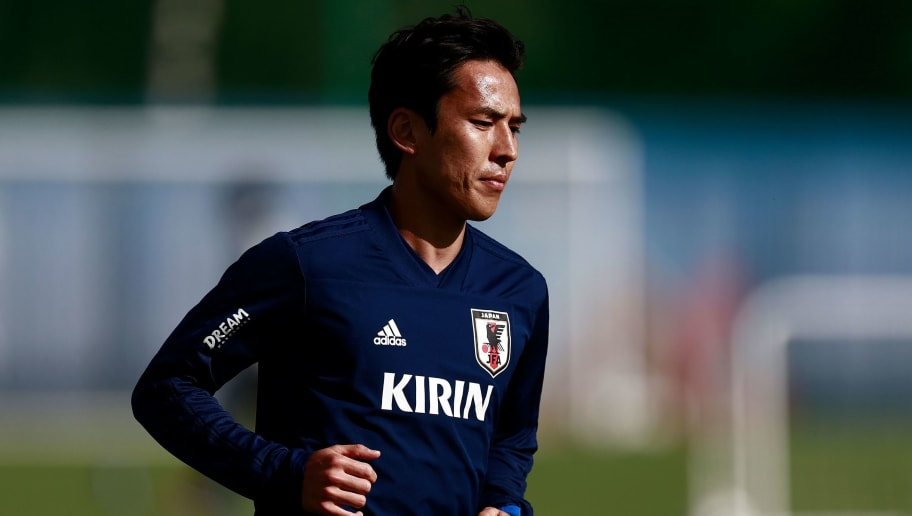 Japan's midfielder Makoto Hasebe takes part in a training session of the Japanese national football team in Kazan on June 14, 2018, ahead of the Russia 2018 World Cup football tournament. (Photo by Benjamin CREMEL / AFP)        (Photo credit should read BENJAMIN CREMEL/AFP/Getty Images)