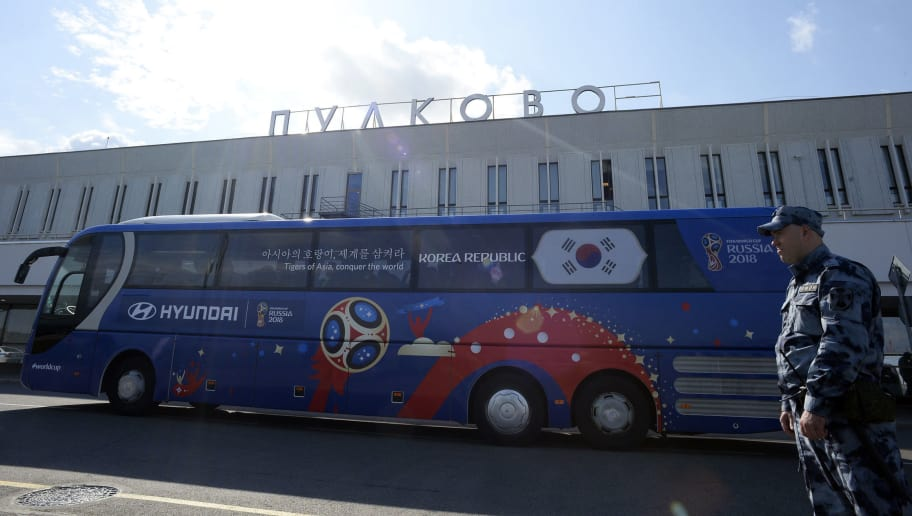 A security guard stands next to the bus of South Korea's national football team as they leave the Pulkovo airport upon their arrival in Saint Petersburg on June 12, 2018, to take part in the 2018 FIFA World Cup football tournament in Russia. (Photo by OLGA MALTSEVA / AFP)        (Photo credit should read OLGA MALTSEVA/AFP/Getty Images)