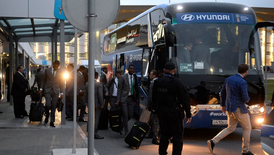 Members of the Saudi Arabia national football team board a bus upon arrival at Saint Petersburg's Pulkovo airport on June 9, 2018, ahead of the 2018 FIFA World Cup football tournament in Russia. (Photo by OLGA MALTSEVA / AFP)        (Photo credit should read OLGA MALTSEVA/AFP/Getty Images)
