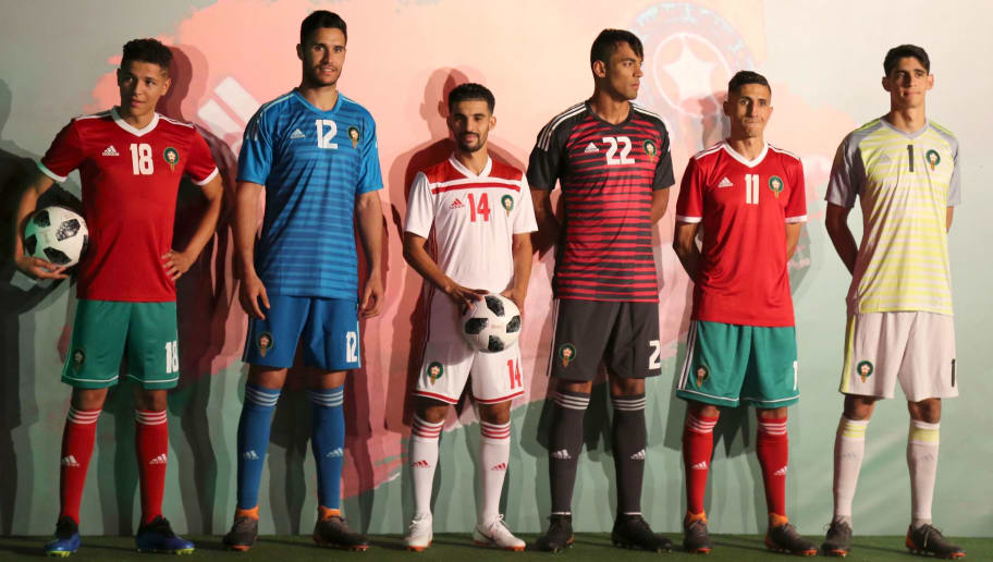 (L to R) A picture taken on May 24, 2018, shows Moroccan national football team midfielder Amine Harit, sporting the new national team home kit, goalkeeper Munir Mohand Mohamedi, sporting the goalkeeper away kit, midfielder Mbark Boussoufa, sporting the team away kit, goalkeeper Ahmed Reda Tagnaouti, sporting the third goalkeeper kit, midfielder Faycal Fajr, sporting the new national team home kit and goalkeeper Yassine Bounou, sporting the goalkeeper home kit during an unveiling ceremony in Skhirat, on the outskirts of the Moroccan capital, ahead of the 2018 FIFA World Cup in Russia. - The 2018 FIFA World Cup will be held between June 14 and July 15, 2018 in 11 Russian cities. (Photo by STRINGER / AFP)        (Photo credit should read STRINGER/AFP/Getty Images)