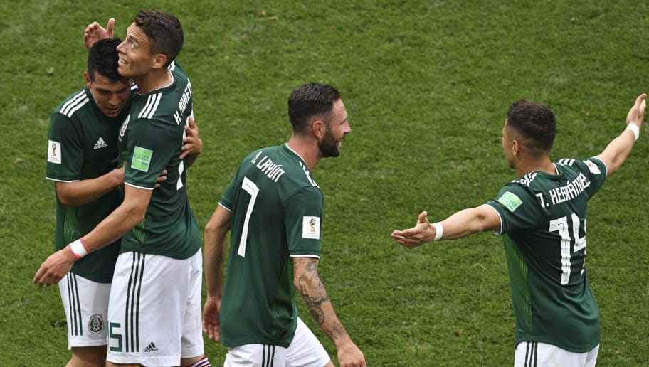 Mexico's players celebrate their goal during the Russia 2018 World Cup Group F football match between Germany and Mexico at the Luzhniki Stadium in Moscow on June 17, 2018. (Photo by Mladen ANTONOV / AFP) / RESTRICTED TO EDITORIAL USE - NO MOBILE PUSH ALERTS/DOWNLOADS        (Photo credit should read MLADEN ANTONOV/AFP/Getty Images)