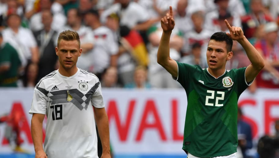 Mexico's forward Hirving Lozano (R) celebrates after scoring their first goal past Germany's defender Joshua Kimmich during the Russia 2018 World Cup Group F football match between Germany and Mexico at the Luzhniki Stadium in Moscow on June 17, 2018. (Photo by Yuri CORTEZ / AFP) / RESTRICTED TO EDITORIAL USE - NO MOBILE PUSH ALERTS/DOWNLOADS        (Photo credit should read YURI CORTEZ/AFP/Getty Images)
