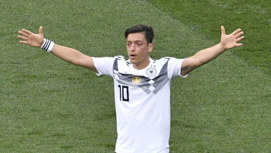 Germany's midfielder Mesut Ozil reacts during the Russia 2018 World Cup Group F football match between Germany and Mexico at the Luzhniki Stadium in Moscow on June 17, 2018. (Photo by Mladen ANTONOV / AFP) / RESTRICTED TO EDITORIAL USE - NO MOBILE PUSH ALERTS/DOWNLOADS        (Photo credit should read MLADEN ANTONOV/AFP/Getty Images)