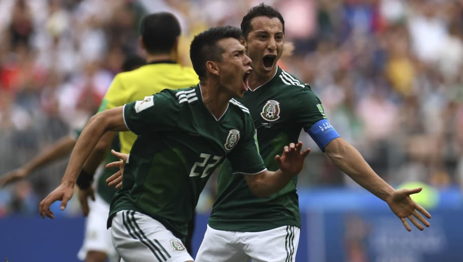 Mexico's forward Hirving Lozano (C) celebrates after scoring a goal during the Russia 2018 World Cup Group F football match between Germany and Mexico at the Luzhniki Stadium in Moscow on June 17, 2018. (Photo by Patrik STOLLARZ / AFP) / RESTRICTED TO EDITORIAL USE - NO MOBILE PUSH ALERTS/DOWNLOADS        (Photo credit should read PATRIK STOLLARZ/AFP/Getty Images)