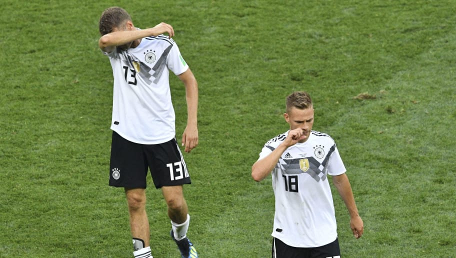 Germany's forward Thomas Mueller (L) and Germany's defender Joshua Kimmich walk off the pitch following their loss during the Russia 2018 World Cup Group F football match between Germany and Mexico at the Luzhniki Stadium in Moscow on June 17, 2018. (Photo by Mladen ANTONOV / AFP) / RESTRICTED TO EDITORIAL USE - NO MOBILE PUSH ALERTS/DOWNLOADS        (Photo credit should read MLADEN ANTONOV/AFP/Getty Images)