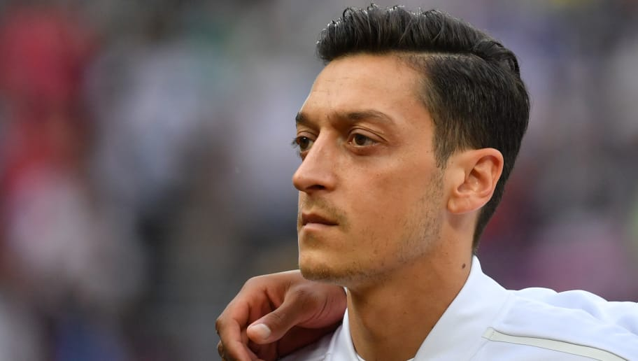Germany's midfielder Mesut Ozil poses before the Russia 2018 World Cup Group F football match between Germany and Mexico at the Luzhniki Stadium in Moscow on June 17, 2018. (Photo by Yuri CORTEZ / AFP) / RESTRICTED TO EDITORIAL USE - NO MOBILE PUSH ALERTS/DOWNLOADS        (Photo credit should read YURI CORTEZ/AFP/Getty Images)