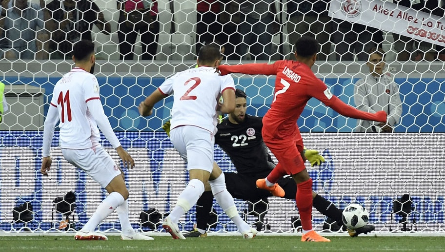 Tunisia's goalkeeper Mouez Hassen (2R) stops a shot by England's midfielder Jesse Lingard during the Russia 2018 World Cup Group G football match between Tunisia and England at the Volgograd Arena in Volgograd on June 18, 2018. (Photo by Philippe DESMAZES / AFP) / RESTRICTED TO EDITORIAL USE - NO MOBILE PUSH ALERTS/DOWNLOADS        (Photo credit should read PHILIPPE DESMAZES/AFP/Getty Images)