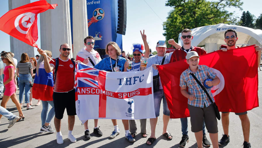 Tunisian and English fans pose as they wait at the official FIFA Fan Fest in Volgograd before the Russia 2018 World Cup Group G football match between Tunisia and England at the Volgograd Arena in Volgograd on June 18, 2018. (Photo by Maxim ZMEYEV / AFP)        (Photo credit should read MAXIM ZMEYEV/AFP/Getty Images)