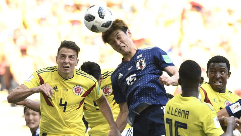 Japan's forward Yuya Osako scores a header past Colombia's defender Santiago Arias (L) during the Russia 2018 World Cup Group H football match between Colombia and Japan at the Mordovia Arena in Saransk on June 19, 2018. (Photo by Filippo MONTEFORTE / AFP) / RESTRICTED TO EDITORIAL USE - NO MOBILE PUSH ALERTS/DOWNLOADS        (Photo credit should read FILIPPO MONTEFORTE/AFP/Getty Images)