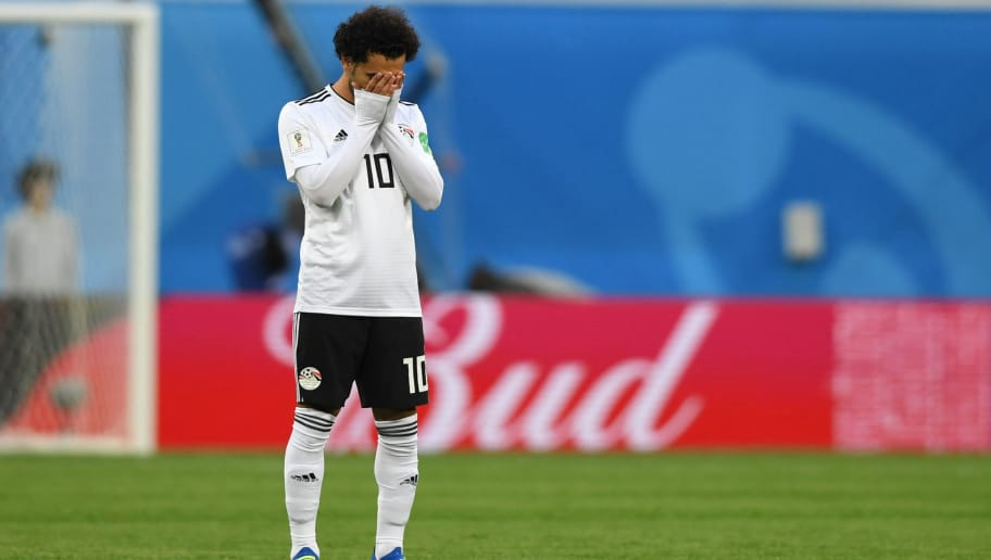 Egypt's forward Mohamed Salah reacts during the Russia 2018 World Cup Group A football match between Russia and Egypt at the Saint Petersburg Stadium in Saint Petersburg on June 19, 2018. (Photo by Olga MALTSEVA / AFP) / RESTRICTED TO EDITORIAL USE - NO MOBILE PUSH ALERTS/DOWNLOADS        (Photo credit should read OLGA MALTSEVA/AFP/Getty Images)