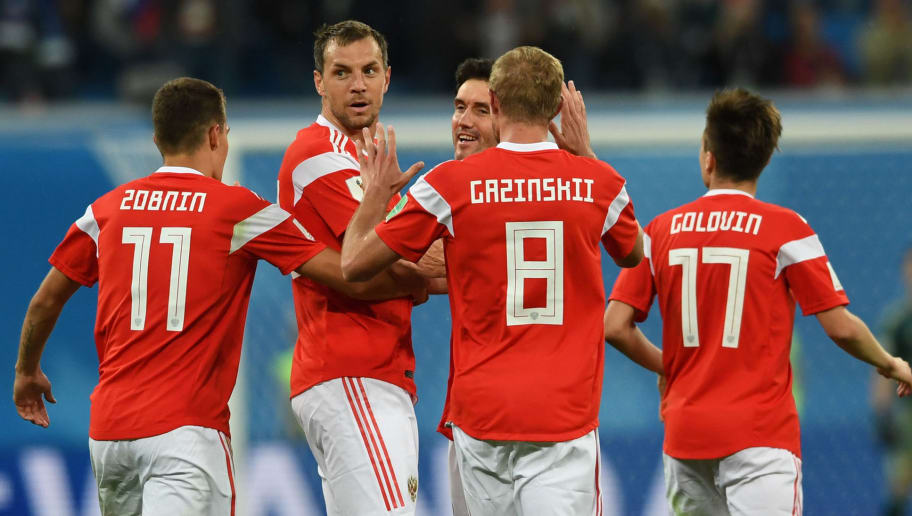 Russia's forward Artem Dzyuba (2ndL) celebrates with teammates after scoring  during the Russia 2018 World Cup Group A football match between Russia and Egypt at the Saint Petersburg Stadium in Saint Petersburg on June 19, 2018. (Photo by Olga MALTSEVA / AFP) / RESTRICTED TO EDITORIAL USE - NO MOBILE PUSH ALERTS/DOWNLOADS        (Photo credit should read OLGA MALTSEVA/AFP/Getty Images)