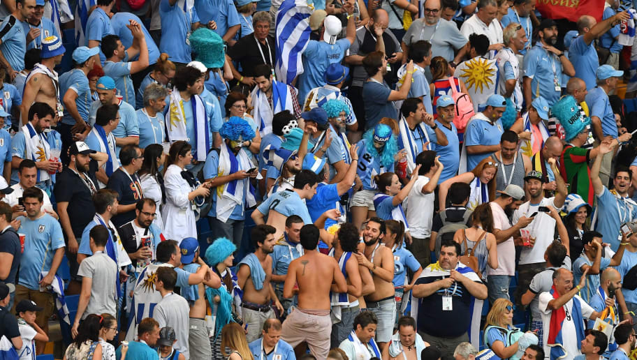 Uruguay's fans celebrate at the end of the Russia 2018 World Cup Group A football match between Uruguay and Saudi Arabia at the Rostov Arena in Rostov-On-Don on June 20, 2018. Uruguay won 1-0. (Photo by JOE KLAMAR / AFP) / RESTRICTED TO EDITORIAL USE - NO MOBILE PUSH ALERTS/DOWNLOADS        (Photo credit should read JOE KLAMAR/AFP/Getty Images)