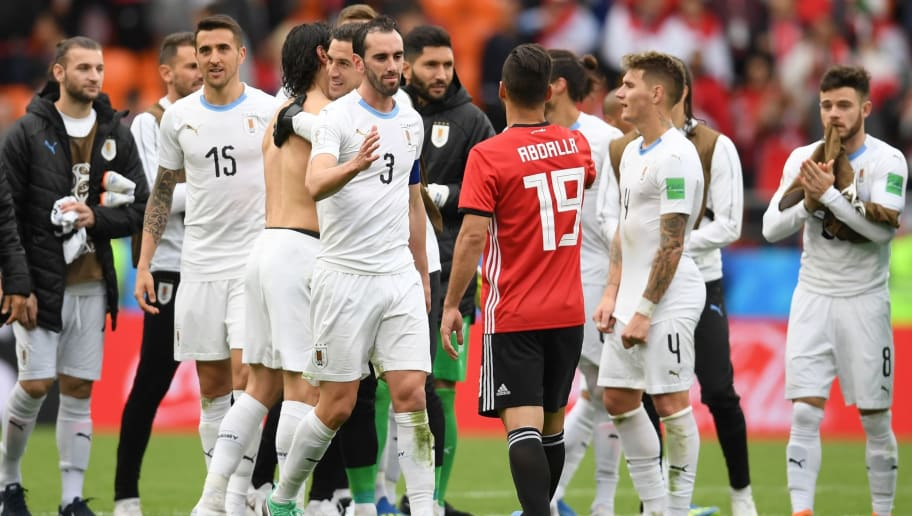 Uruguay's defender Diego Godin (CL) greets Uruguay's defender Sebastian Coates (CR) after the final whistle of the Russia 2018 World Cup Group A football match between Egypt and Uruguay at the Ekaterinburg Arena in Ekaterinburg on June 15, 2018. (Photo by JORGE GUERRERO / AFP) / RESTRICTED TO EDITORIAL USE - NO MOBILE PUSH ALERTS/DOWNLOADS        (Photo credit should read JORGE GUERRERO/AFP/Getty Images)