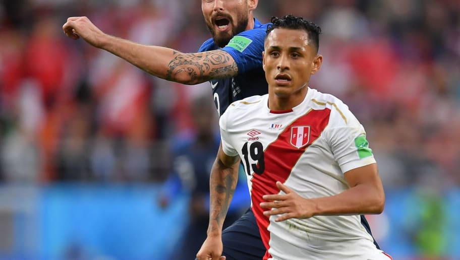 France's forward Olivier Giroud (L) passes the ball next to Peru's midfielder Yoshimar Yotun during the Russia 2018 World Cup Group C football match between France and Peru at the Ekaterinburg Arena in Ekaterinburg on June 21, 2018. (Photo by HECTOR RETAMAL / AFP) / RESTRICTED TO EDITORIAL USE - NO MOBILE PUSH ALERTS/DOWNLOADS        (Photo credit should read HECTOR RETAMAL/AFP/Getty Images)